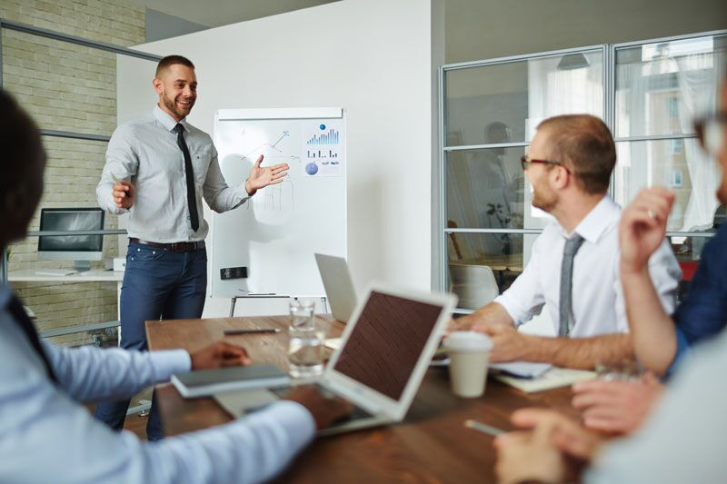 businessman holding staff meeting, steps to protect your company against common commercial risks
