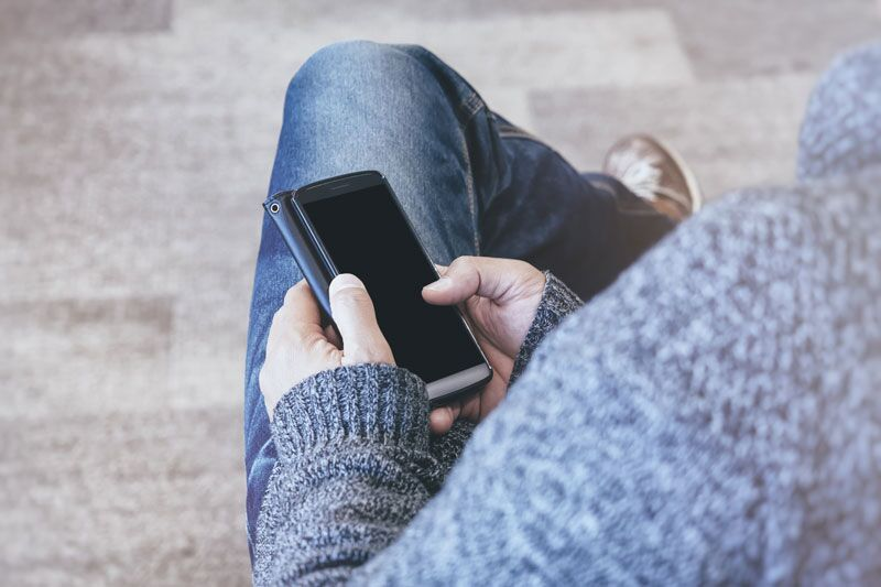 man with a smartphone, what businesses need to know about the TCPA