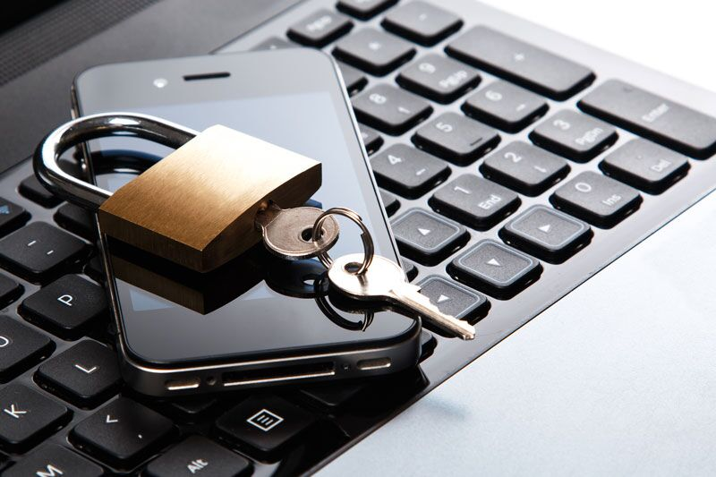 laptop and smartphone protected by padlock, preventing data breach