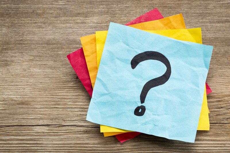 question mark written on sticky note, essential questions you need to ask about your commercial coverage