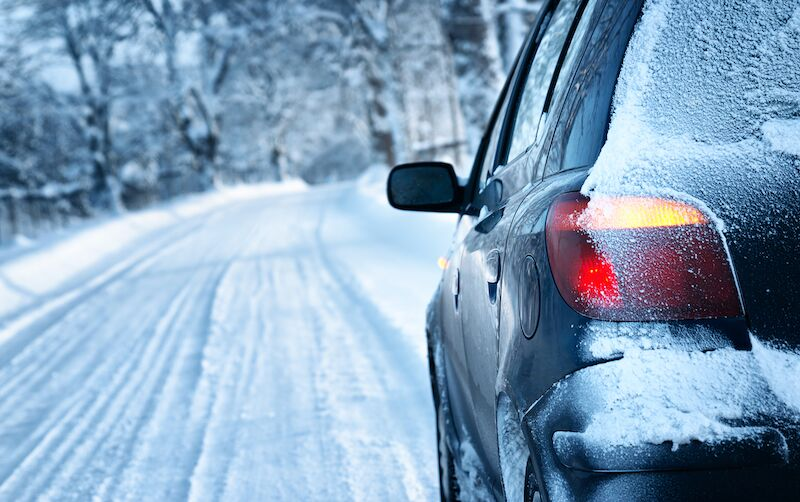 car driving in the snow, stay safe as you drive this winter