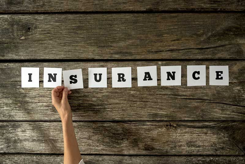 spelling out insurance with paper cutouts, common insurance misconceptions